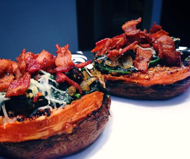 2014 01 07 Roasted portobello mushrooms stacked with fried tomatoes, sautéed spinach and kale with garlic and onions and topped with the almighty bacon!